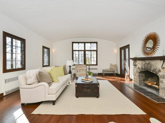 There are archways, French doors and refinished hardwood floors throughout.