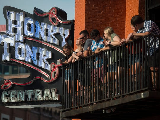 Patrons at Honky Tonk Central during the 2018 CMA Music