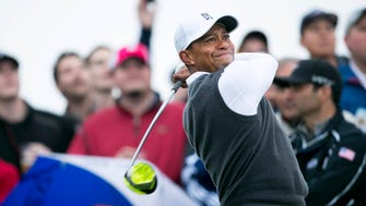 Tiger Woods makes his tee shot to start his second round of the Waste Management Phoenix Open at TPC Scottsdale.