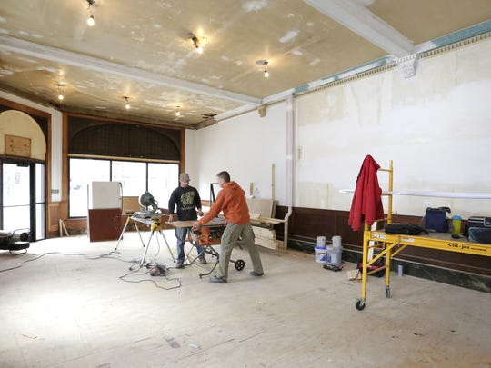 Seth Lang and Eric Pollesch work on remodeling a storefront on Watson Street in downtown Ripon on Thursday.