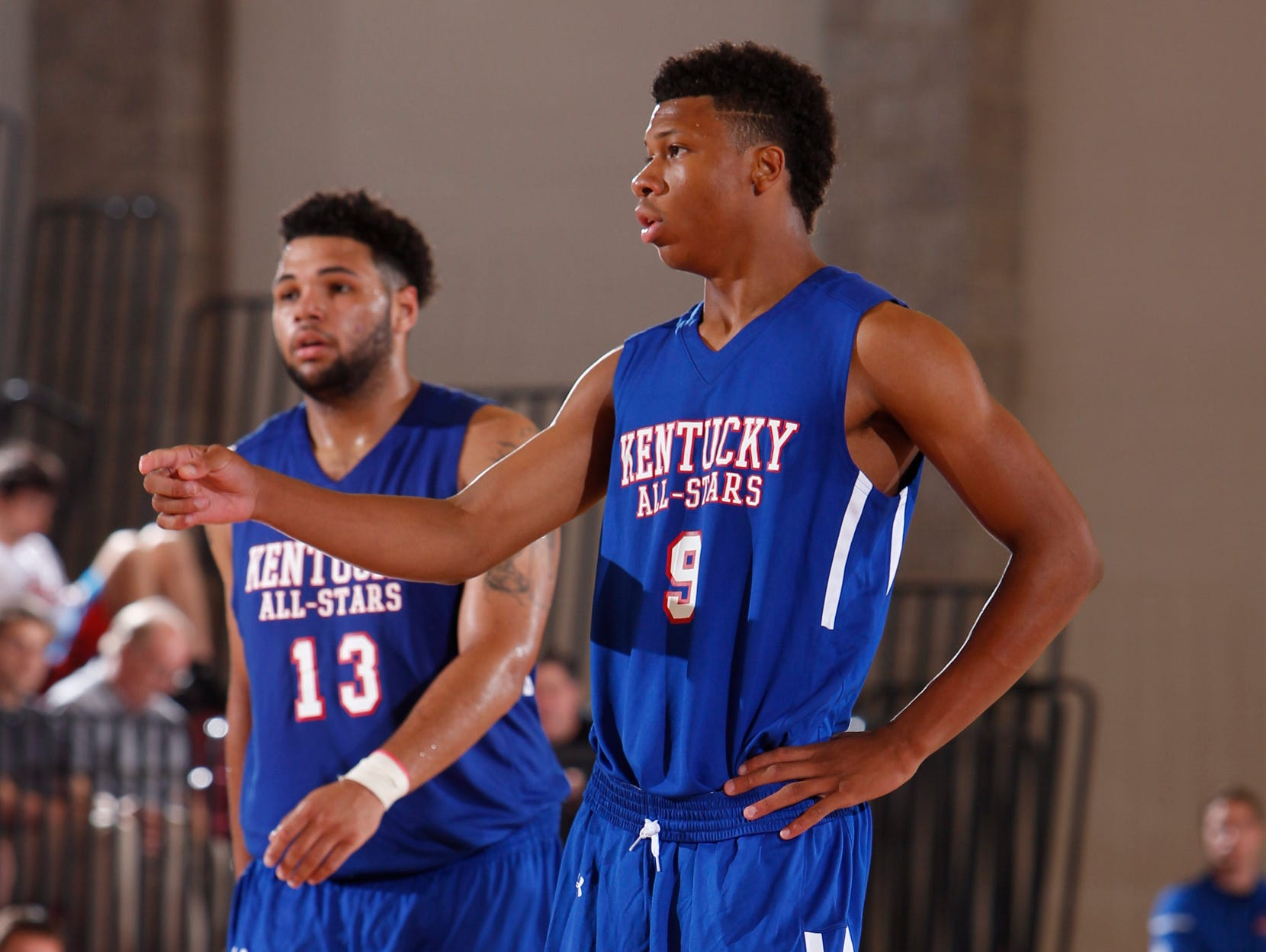 Kentucky All-Star Dwayne Sutton, right and Kentucky All-Star Justin Miller look to the bench for instruction in the second half. The Kentucky versus Indiana Boys All-Star Classic was held, Friday, June 12, 2015 at the Clive Beck Center in Lexington. Photo by Jonathan Palmer/Special to the C-J