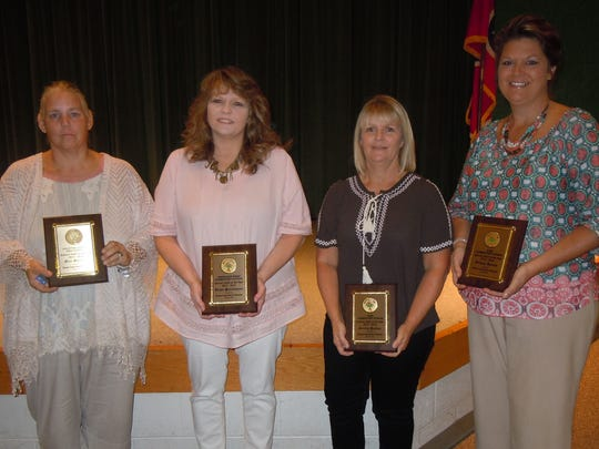 Support Staff of the Year awards went to, from left,