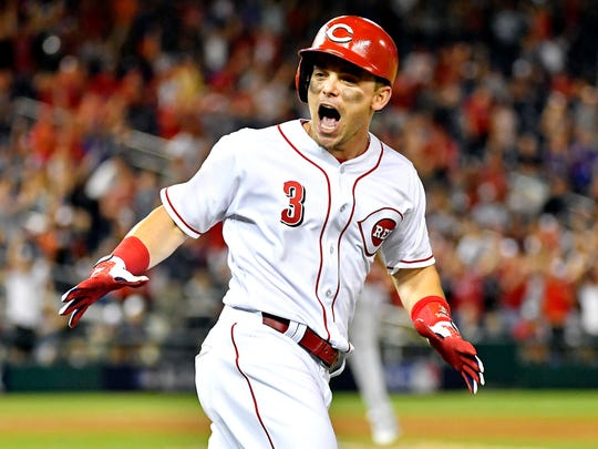 National League infielder Scooter Gannett of the Cincinnati Reds (3) celebrates hitting a two run home run during the ninth inning against the American League in the 2018 MLB All Star Game at Nationals Ballpark.