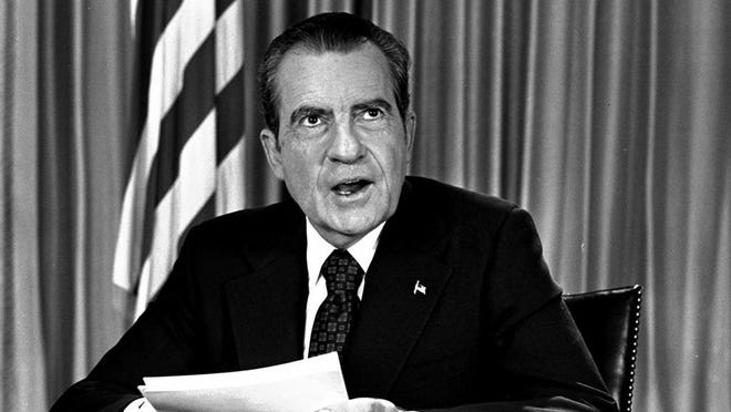 President Nixon sits in his White House office, August 16, 1973, as he poses for pictures after delivering a nationwide television address dealing with Watergate. Nixon repeated that he had no prior knowledge of the Watergate break-in and was not aware of any cover-up.