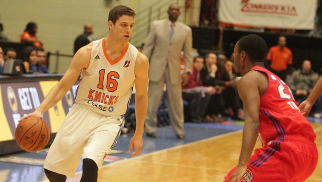 Westchester Knicks guard Jimmer Fredette handles the ball while being guarded by Grand Rapids' Sam Thompson during an NBA D-League game at the Westchester County Center on Monday, November 30th, 2015.