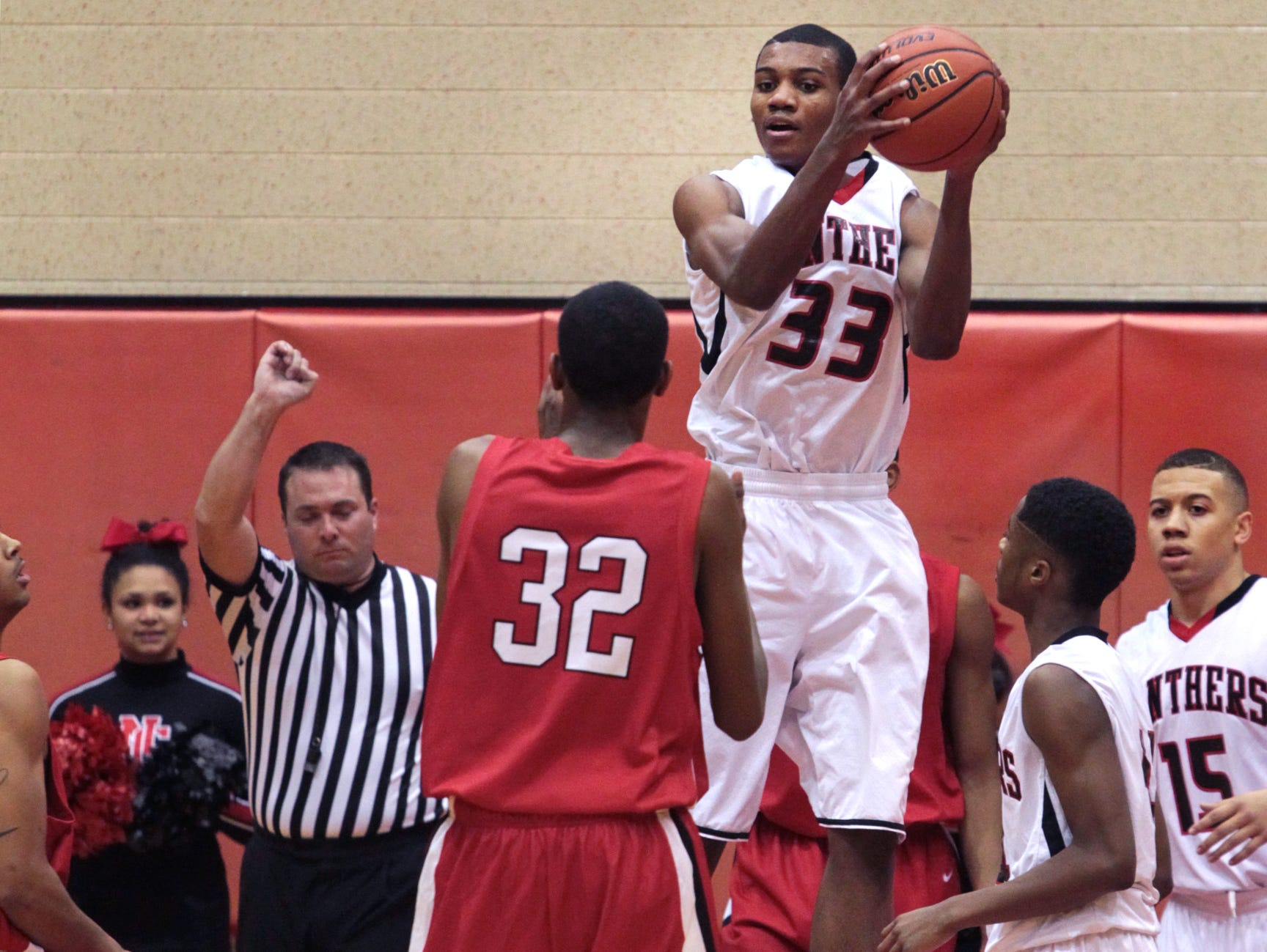 North Central's Antonio Singleton comes down with a rebound against Pike, Nov. 27, 2013.
