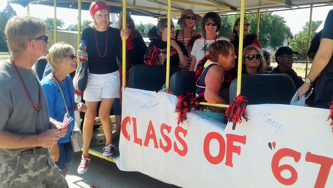 Looking younger than their age, members of the Laurens High School class of 1967 rode this people-mover in the town's Wine Festival parade on July 8.