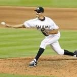 Miami Marlins relief pitcher Steve Cishek (31) throws against the Atlanta Braves in the ninth inning during a baseball game in Miami. The Seattle Mariners' offseason makeover continued Monday, Dec. 14, 2015, with the club signing right-handed reliever Steve Cishek to a two-year contract with the opportunity to end up as the team's closer. Cishek, 29, split last season with Miami and St. Louis and appeared in 59 games combined for the two teams. (AP Photo/Joe Skipper, File)