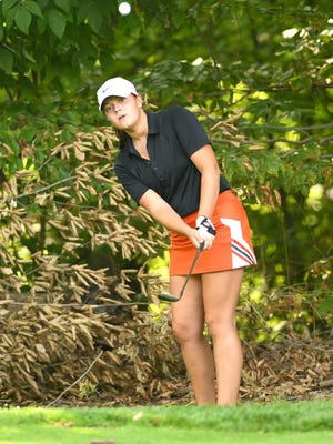 Mattie Muckleroy of Hoover chips to the green and finished with a par on the fourth hole in a match against Perry at Arrowhead Golf Club on Wednesday. The Vikings shot a 9-hole scoring record 151 in their win over the Panthers.
