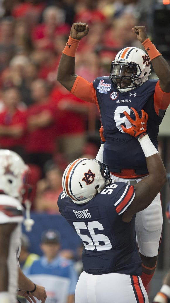 Auburn quarterback Jeremy Johnson (6) celebrates with