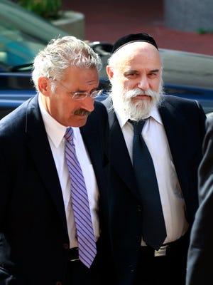 Levy Izhak Rosenbaum, left, of Brooklyn, N.Y, arrives with his attorney Richard Finkel, for his sentencing in Trenton, N.J., Wednesday, July, 11, 2012, for what prosecutors say is the first ever federal conviction for illegally selling human kidneys for profit. Rosenbaum pleaded guilty last October to brokering three illegal kidney transplants for New Jersey-based customers in exchange for payments of $120,000 or more.