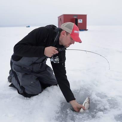 Fishing guide and entrepreneur JJ Malvitz pulls a whitefish