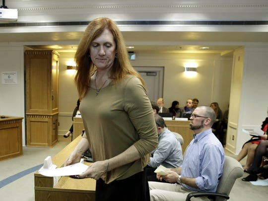 Kathryn Mahan of Puyallup, who identifies as a transgender woman, stands up after testifying in opposition to a bill that would eliminate Washington's new rule allowing transgender people use gender-segregated bathrooms and locker rooms in public buildings consistent with their gender identity at the Capitol in Olympia, Wash.
