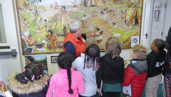 Retired Greece Central School District teacher Kathie Firkins, of Greece, gives a tour of the Greece Museum to a group of children in October 2017.  Firkins is a volunteer at the family-friendly museum.