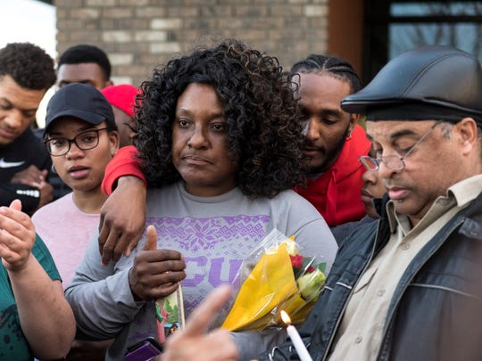 Any Harris, mother of Jontell Reedom, is comforted by her son Frederich Vernon on Tuesday, March 13, 2018 along Cross Avenue during a candlelight vigil among family and friends of her son. An altercation between Jontell and Tulare Police ended there on Monday. Reedom, a standout athlete at Tulare Union High School in 2008, died from gunshots he received during the struggle.