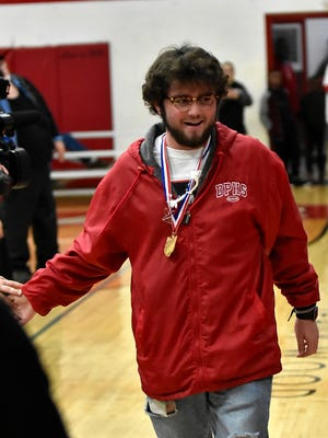 Daniel Daily of the Wildcats State Division III Championship team is announced at the Deer Park State Title Basketball Celebration, March 28, 2018.