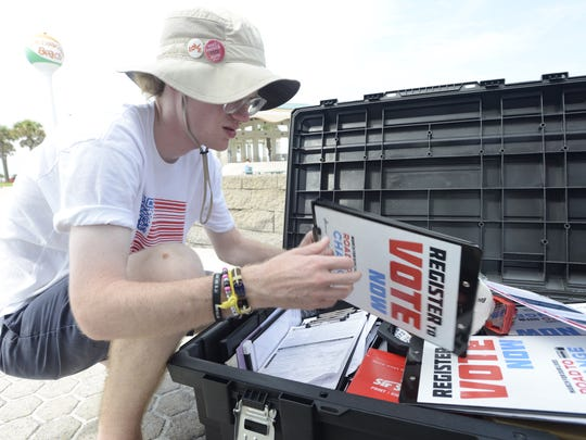 Tom Bethany, a voter registration coordinator, packs up supplies after an event Monday, July 30, 2018, at Pensacola Beach.