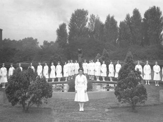 This 1946 photo shows the first IU School of Nursing pinning ceremony in the Ball Nurses Sunken Garden at IUPUI. Students had petitioned the school for their pinning ceremony to be held there.