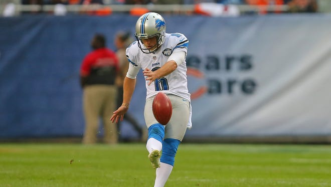 Oct 2, 2016; Chicago, IL, USA; Lions place kicker Sam Martin kicks off during the first half against the Chicago Bears at Soldier Field.