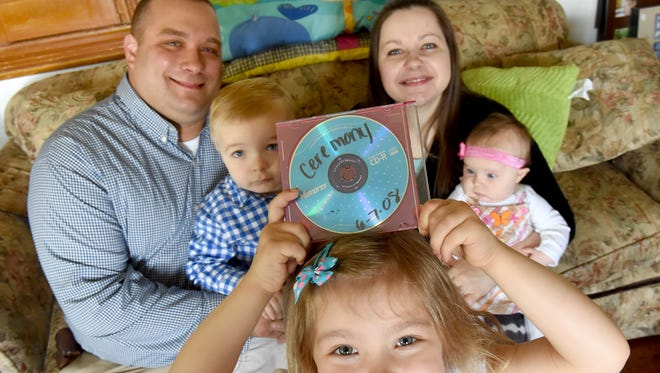 Nine years after their wedding, Joshua and Erin Bruno recovered their wedding music, which was recently found at the Yorktowne Hotel and mailed to them. The couple are seen here with their three kids: Winter, 4, center, Joshua, 2, left, and 3-month-old Annabelle, in the living room of their White Hall, Md. home.