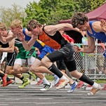 Runners compete in the 100 at the State C track meet in Laurel.