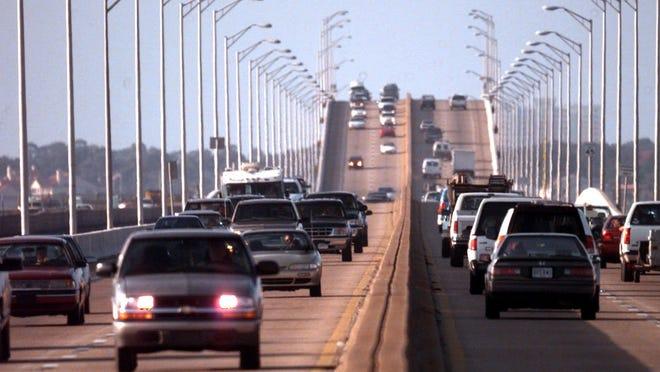 Morning rush hour traffic crawls across Pensacola Bay Bridge.