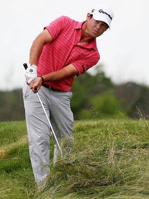 Brian Harman hits out of the deep fescue on No. 17 during the third round of the U.S. Open at Erin Hills.