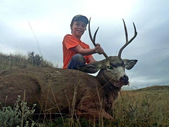 Declan Bergstrom with his 2x3 mule buck.