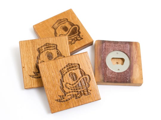 These coasters featuring the Duck mascot conveniently have a bottle opener on the back of each one, plus they are made from recycled wine barrels, $40 for a set of four. uoduckstore.com.