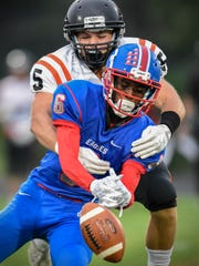 Shannon Spears Jr. of Apollo tries to make an interception in front of Tech's Trent Meyer during the Friday, Sept. 1, game at Apollo High School in St. Cloud.