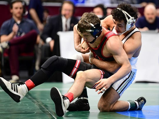 Lehigh's Darian Cruz, right, controls Rutgers Nick Suriano during the 125-pound weight class match of the NCAA Division I Wrestling Championships, Friday, March 16, 2018, in Cleveland. Suriano won the match.