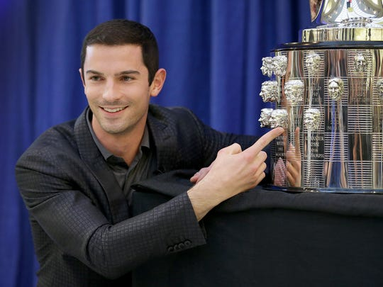 Alexander Rossi poses for photos following the unveil