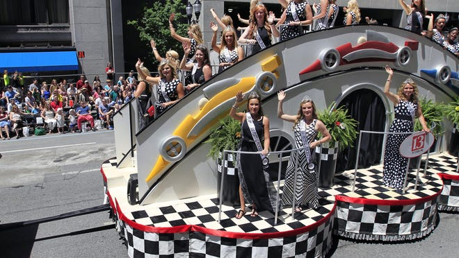 The 500 Festival Princesses ride on their float going down South Pennsylvania Street during the 500 Festival Parade in 2014.
