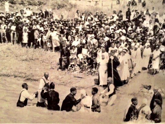 "This Maclean Dameron photo from the 1991 book ""Currents ‑ Henderson's River Book"" shows nearly 100 people who were baptized at the foot of Third Street on June 15, 1941, during a ceremony organized by Greater Norris Chapel Baptist Church, First Missionary Baptist Church, Seventh Street Baptist Church and Calvary Baptist Church."