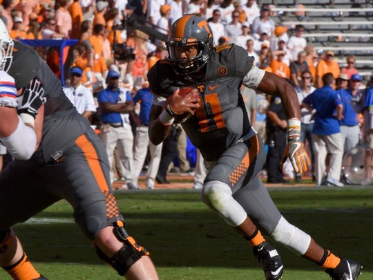 Tennessee quarterback Joshua Dobbs (11) run during first half action against Florida Saturday, September 24, 2016 at Neyland Stadium in Knoxville, Tenn.