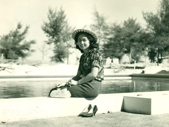 Mom poses in an undated photo from the 1950s, somewhere in Thailand.