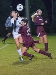 Shippensburg's Julia Nye (25) crashes into Mick Heinbaugh