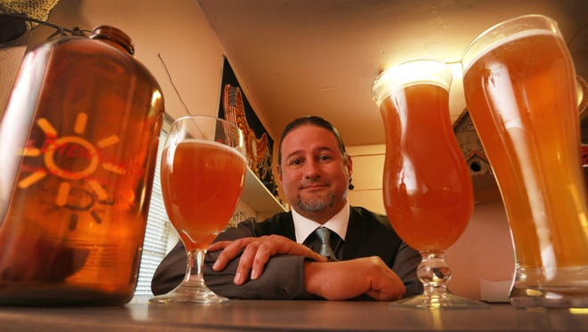 David Slocum of Sun Brewing Co. shows some of his beers Thursday.