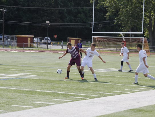 Johnson City's Alec Lopez battles for the ball with