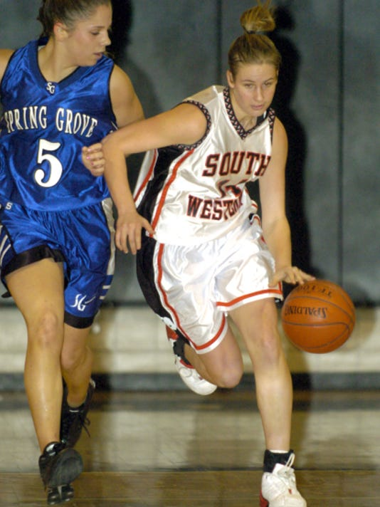 Nikki Lobach, right, starred on the South Western basketball team before graduating as the Mustangs' all-time leader in points in 2004. She now goes by her married name, Nikki Horanburg and recently finished her first year as West Shore Christian head coach.
