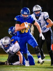 St. Cloud Cathedral tight end James Anderson runs with