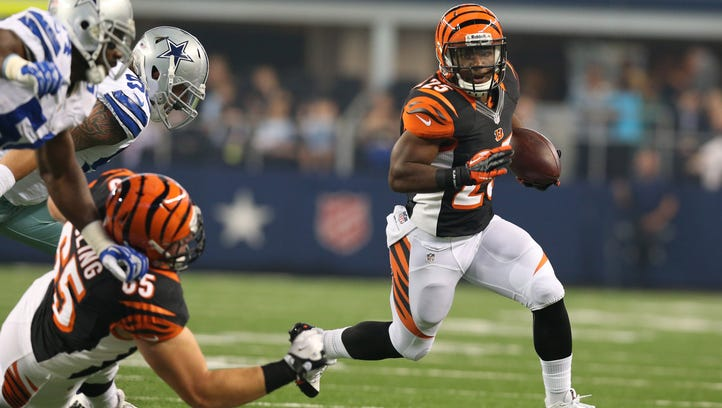 Cincinnati Bengals running back Giovani Bernard (25) runs with the ball against the Dallas Cowboys in the first quarter at AT&T Stadium.