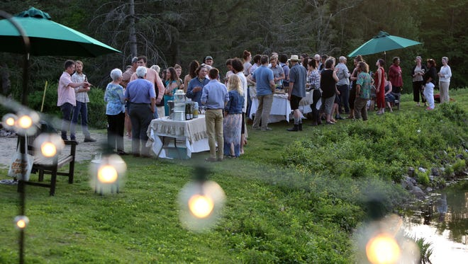 Members of the local agricultural community attend a farm dinner prepared by chef Zak Pelaccio of Fish & Game in Hudson at Glynwood's boat house in Cold Spring May 18, 2017.