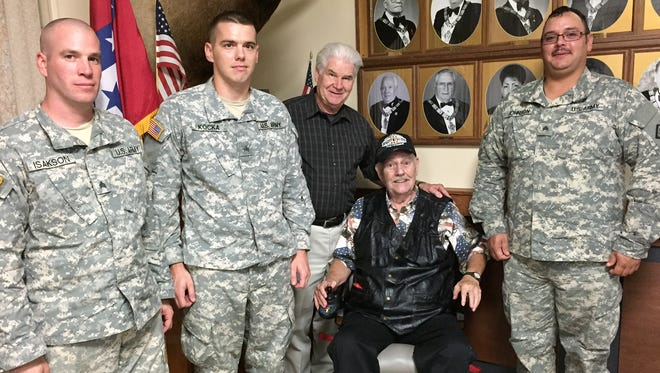 """Veterans past and present were honored Saturday at a luncheon sponsored by Max and Sharon Rainey. The annual lunch is the Raineys' way of remembering the sacrifices of our veterans. Pictured are: (from left) three soldiers from the Arkansas Army National Guard, 224th maintenance company, host Max Rainey (in wheelchair) and Representative-Elect Jack Fortner. Fortner and Rainey, both veterans themselves, said, """"We can never do enough to honor those who serve to protect us."""""""