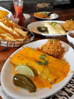The beef and chicken enchiladas, garnished with chips, salsa and beans, is a popular dish at the Iron Horse Grill in downtown Jackson.