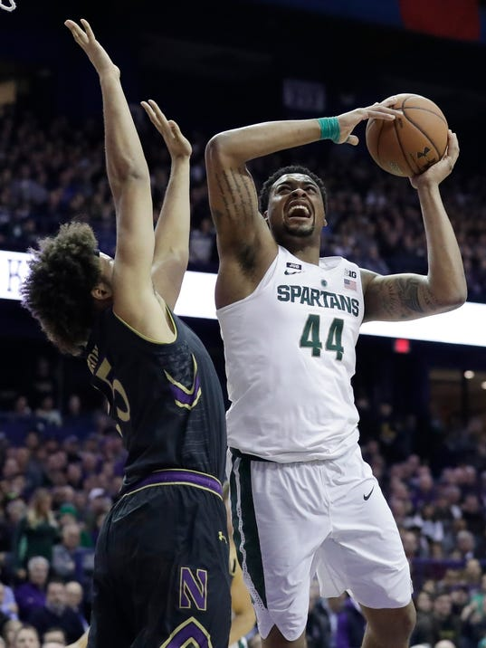 Michigan State forward Nick Ward, right, goes up for a shot against Northwestern center Barret Benson during the first half of an NCAA college basketball game Saturday, Feb. 17, 2018, in Rosemont, Ill. (AP Photo/Nam Y. Huh)