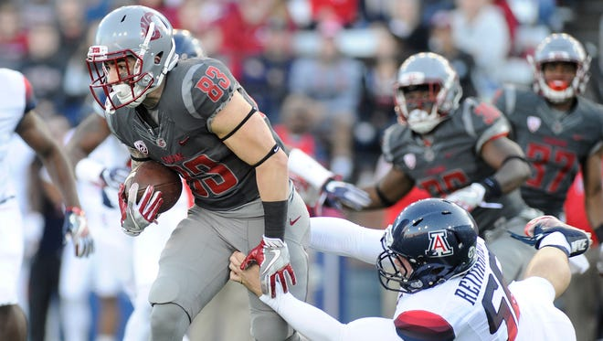 Washington State wide receiver Kaleb Fossum breaks away from the Arizona Wildcats defense during the Cougars' 69-7 win in 2016.