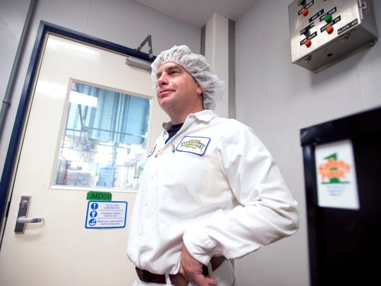 """David Fitzgerald, front line manager at the Ben & Jerry's factory in St. Albans, explains the process of starting production for a new flavor. To """"change a line"""" from one flavor to the next takes at least two hours, required extensive cleaning of equipment, testing of news ingredients once everything is prepped and time for quality control."""