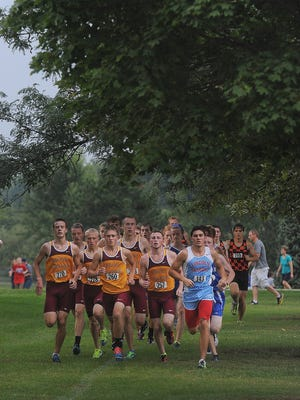 Varsity boys run during the Butler Invitational at Kuehn Park in Sioux Falls on Tuesday, Sept. 1, 2015.
