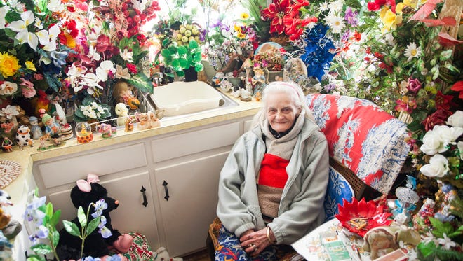 "With ice still melting on the streets outside, 86-year-old Myrtle Cason sits for a portrait inside her kitchen where artificial flowers give off a sense of the approaching spring. ""I love to decorate,"" said Cason of her home filled with stuffed animals, plastic plants and figurines."